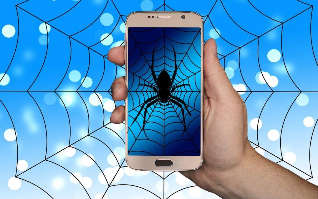 smartphone-avec-araignée-en-fond-écran